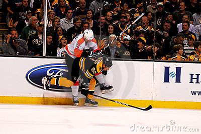 Marchand checks van Riemsdyk Editorial Stock Image