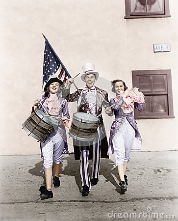 Free Marching Band Performing In A Parade With An American Flag Royalty Free Stock Image - 52018476
