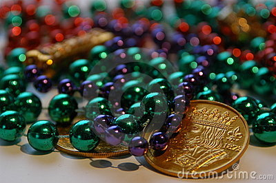 Mardi gras beads and coins