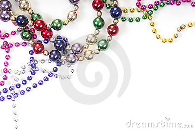 Mardi gras beads on white