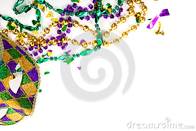 A Mardi gras mask and beads on a white background with copy spac