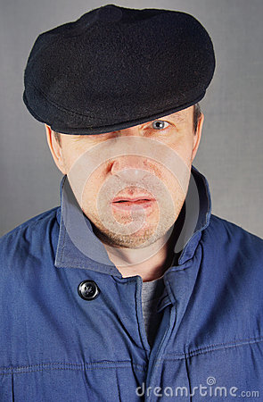 Marginal man in a cap