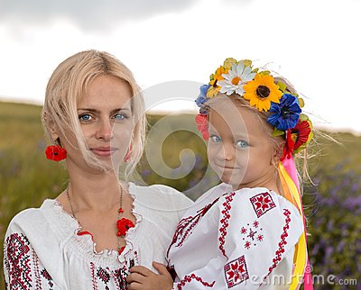 Mother and daughter in ukrainian national costumes