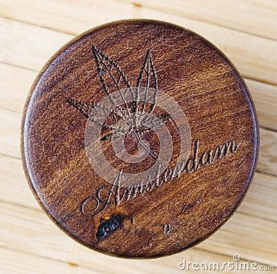 Marijuana symbol woodcarving