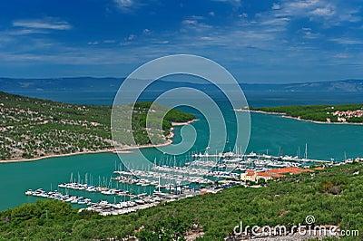 Marina in turquoise lagoon at Adriatic sea