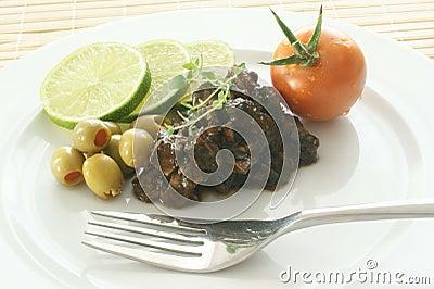 Marinated calamari salad with olive and tomato