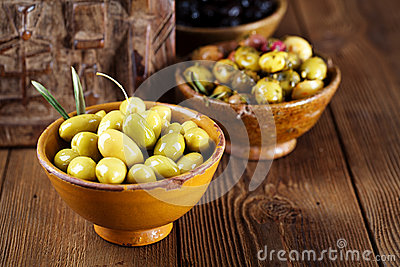 Marinated Olives in bowls with moroccan  ornament on wood