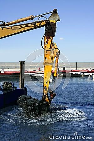 Marine dredging digging sea bottom black mud
