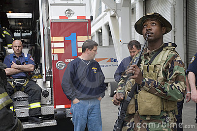 Marine with firefighters Editorial Stock Photo