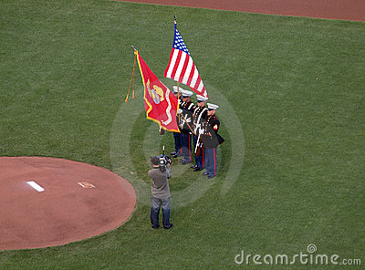 Marines hold flags during national anthem Editorial Photo