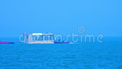 Maritime transport, ship is delivering house stock footage