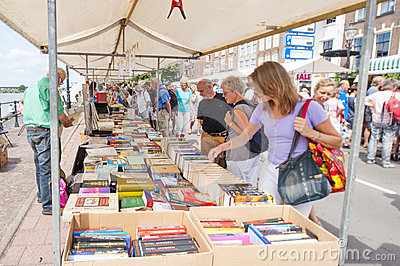 Market booth with second hand books and shopping people Editorial Stock Image