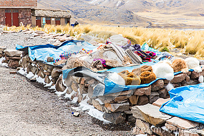 Market.Road Cusco-Puno near Lake Titicaca, Peru, South America. Colorful blanket, cap, scarf, cloth, ponchos from  wool of alpa