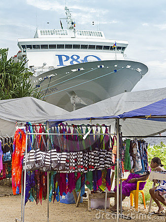 Market stalls and cruise ship docked in Port Vila. Editorial Stock Image