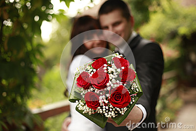 Married couple with a bouquet