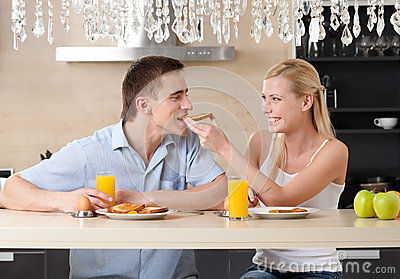 Married couple has breakfast in the kitchen