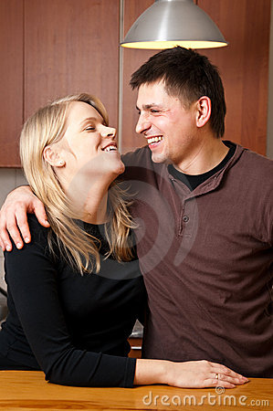 Married couple in kitchen