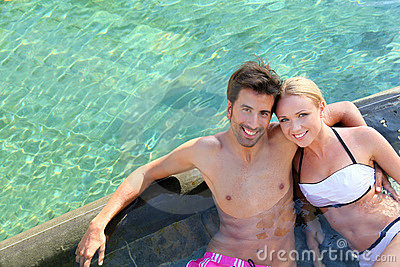 Married couple in resort pool