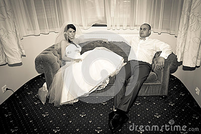 Married couple resting on the sofa