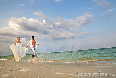 A married couple running in sunshine