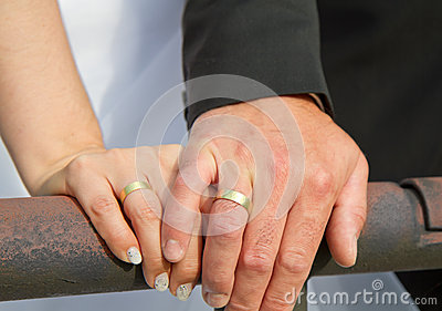 Married couple shows wedding rings