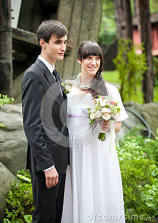 Married couple standing together in park