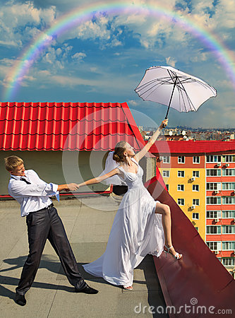 Married couple with white umbrella on the roof