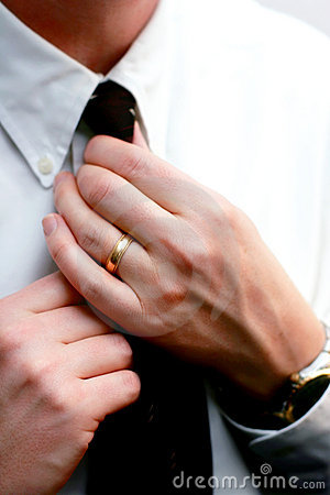 Married Hands Straighten a Necktie