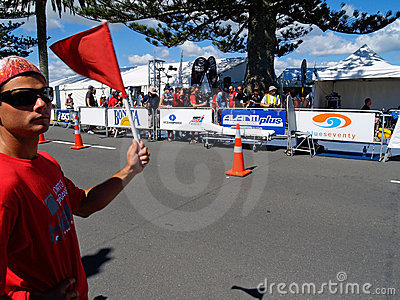 Marshal and flag in half ironman event. Editorial Photo