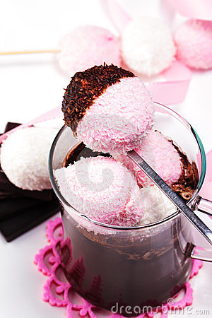 Marshmallow dunked in hot chocolate