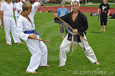 Martial Art Master Benj Lee with Bo and Tonfa Editorial Photography