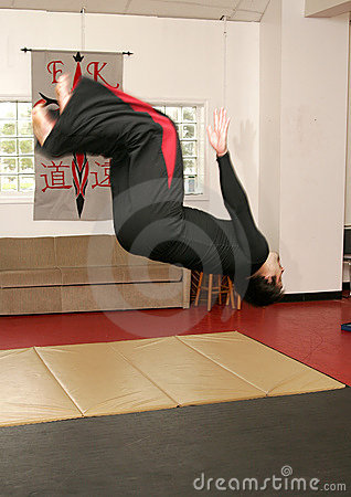 Martial artist doing backflip