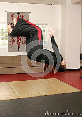 Martial artist doing backflip