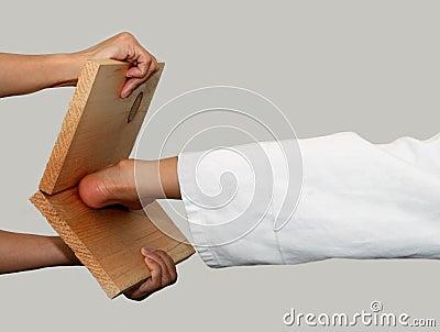 Karate kick breaking board