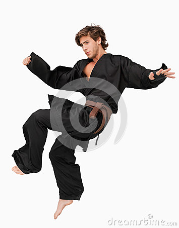 Martial arts fighter performing a jump kick
