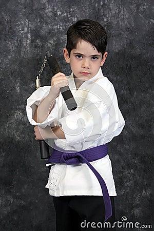 Martial arts nun chuks boy
