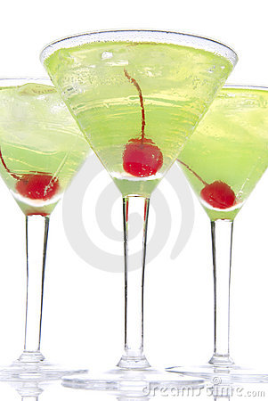 Martini alcohol cocktails in row yellow and green