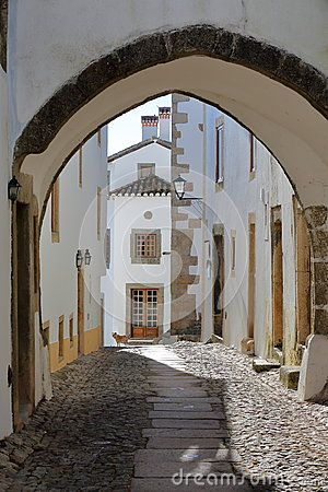 Free MARVAO, PORTUGAL: A Typical Narrow Cobbled Street With Whitewashed Houses And Arcades Stock Images - 86224444