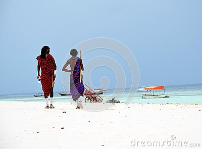 Masai walking at the beach, Zanzibar Editorial Stock Photo