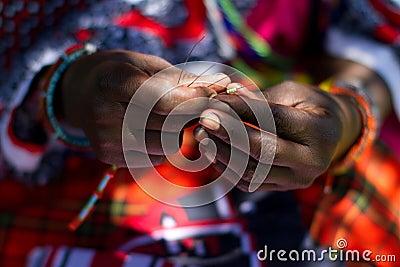 Masai woman beading