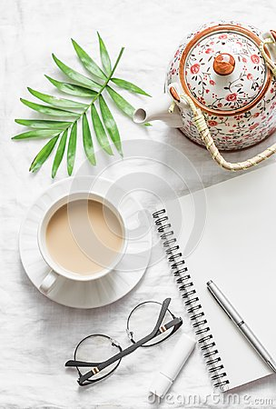 Free Masala Tea, Teapot, Notepad, Glasses, Pen, Green Flower Leaf On White Background, Top View. Morning Inspiration Planning. Stock Image - 111414831
