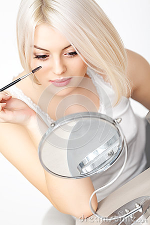 Mascara Applying. Woman applying mascara on Eyelashes. Eye Makeup