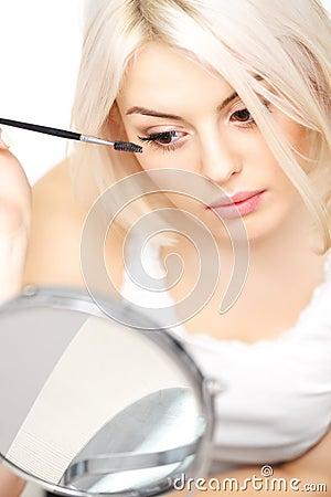 Mascara Applying. Woman applying mascara on eyelashes. Eye Makeup