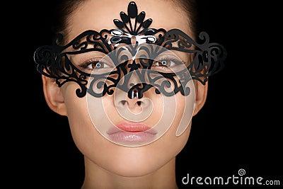 Mask. Beauty woman wearing carnival mask