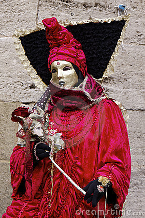 Mask and red robe