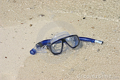 Mask and snorkel on the sand