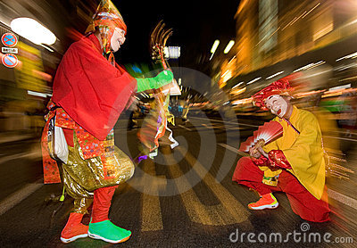 Masked dancers at a night festival in Japan