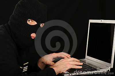 Masked man and computer