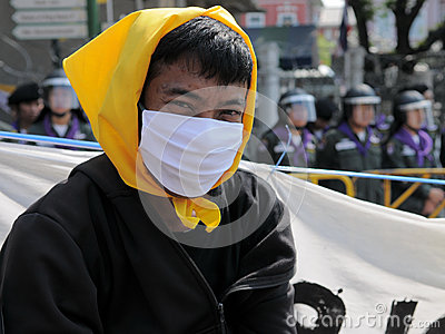 Masked Yellow-Shirt Protester Editorial Image