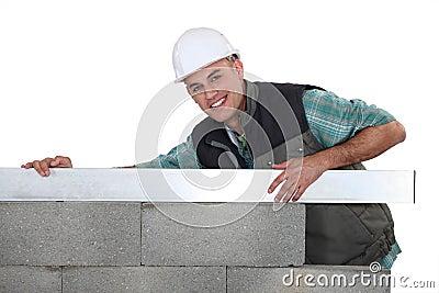 Mason building a wall.
